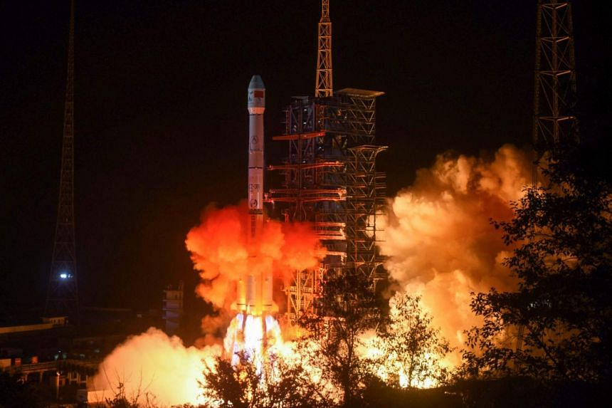 This file picture taken early on Dec 8, 2018, shows a rocket transporting the Chang'e-4 lunar rover lifting off from the Xichang launch centre in China.