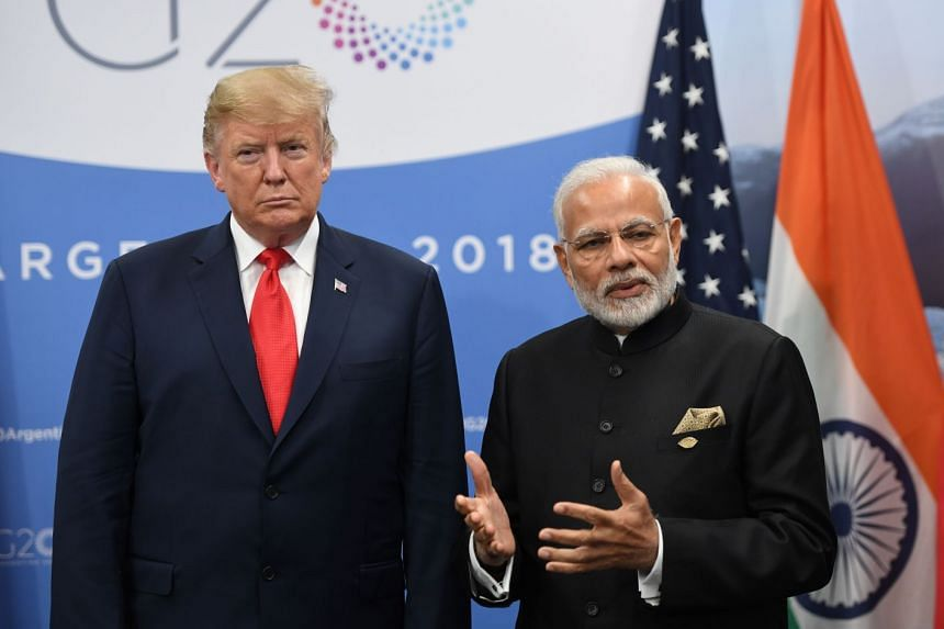 Trump listening to Modi during a meeting on the sidelines of the G-20 Leaders' Summit in Argentina.