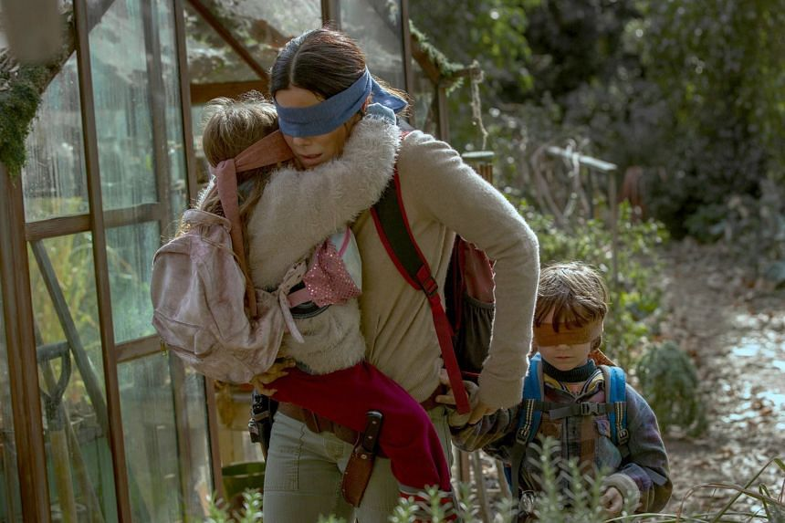 Starring Sandra Bullock, Bird Box centres on an unknown entity that compels anyone who sets eyes on it to kill himself so folk must blindfold themselves when venturing outdoors.