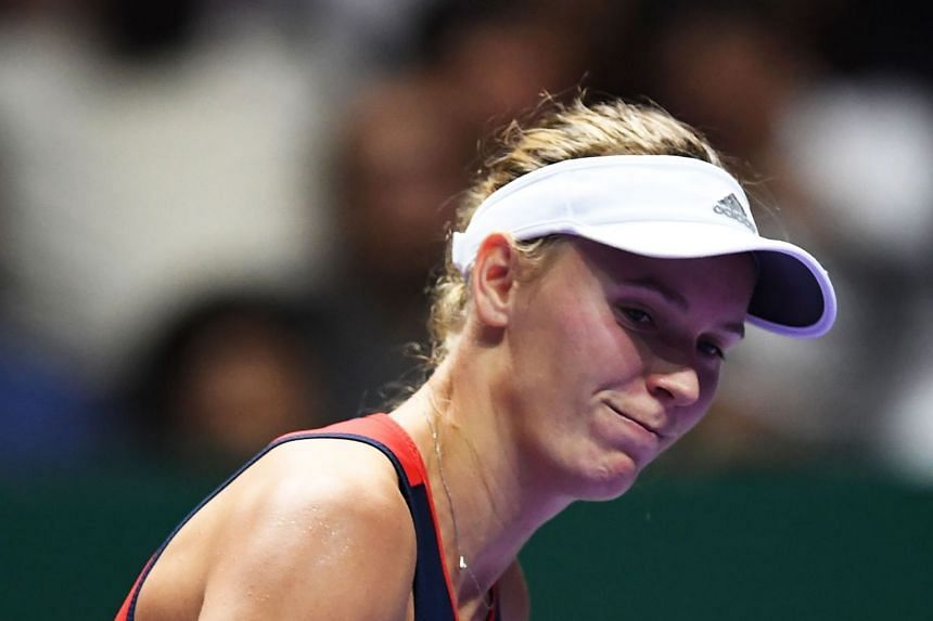 File photo of Denmark's Caroline Wozniacki during th singles match at the WTA Finals tennis tournament in Singapore, on Oct 25, 2018.