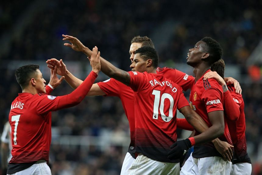Marcus Rashford (centre) celebrates scoring Manchester United's second goal with team mates.