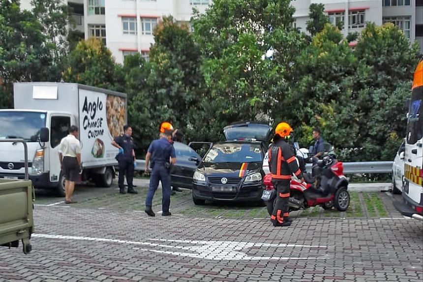 Rescuers at the carpark of Block 462 Sembawang Drive, where a toddler locked himself in a car on Jan 3.