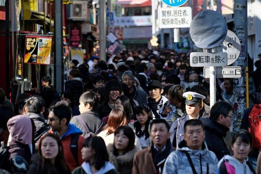 People walking down Takeshita Street in Tokyo's fashion district of Harajuku on Jan 1, 2019.