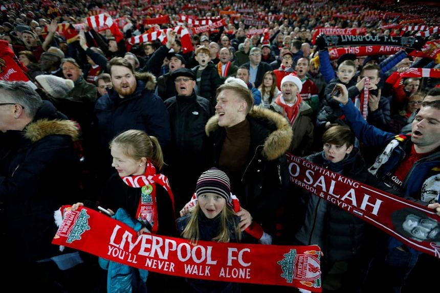Liverpool fans before the match between Arsenal at Anfield, Liverpool, Britain on Dec 29, 2018.