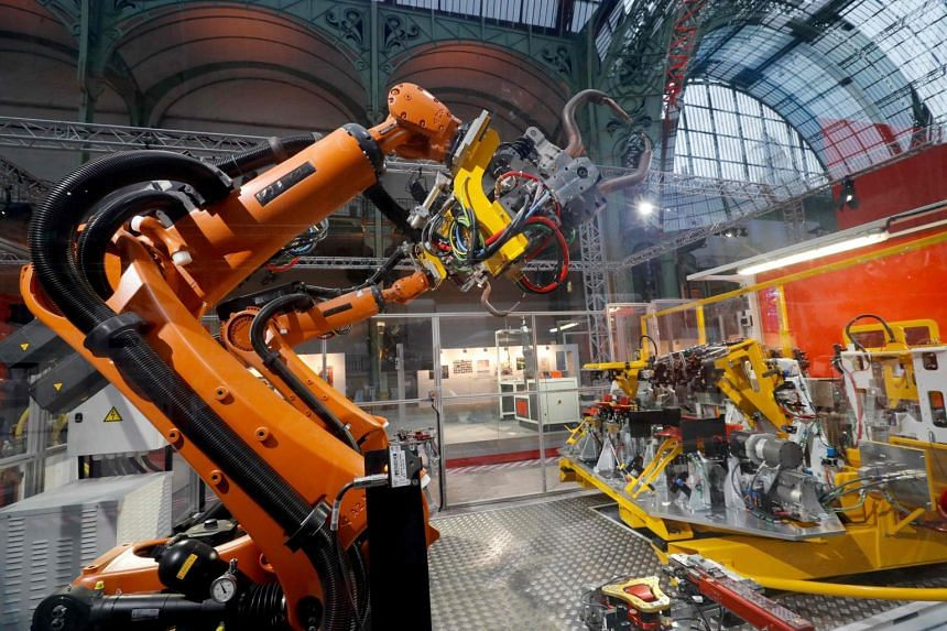 An assembly line robot at an exhibition at the Grand Palais in Paris, France, on Nov 22, 2018.