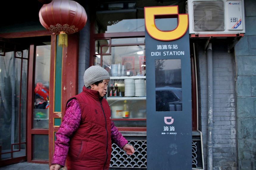 A Didi Chuxing ride-hailing stand in Beijing. The firm's new financial products bring it into competition with Alibaba Group and Tencent.