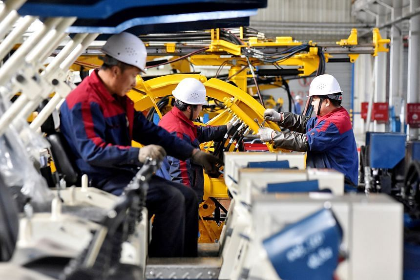 A drilling machine production line at a factory in Zhangjiakou, Hebei province. In China, the Caixin Media and IHS Markit Purchasing Managers' Index fell to 49.7 from 50.2, its lowest reading since May 2017. That confirms a trend seen in the official