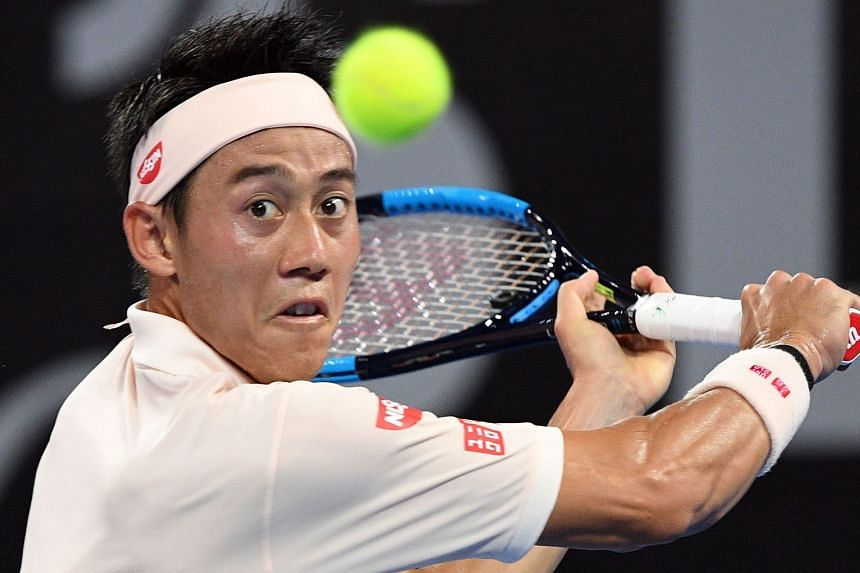 Nishikori hits a return against Bulgarian's Grigor Dimitrov.