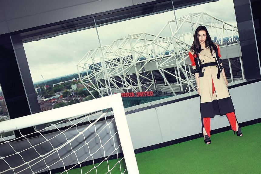 Kim Lim at Hotel Football, where her family has a private suite. The hotel is next door to Manchester United's Old Trafford football stadium.