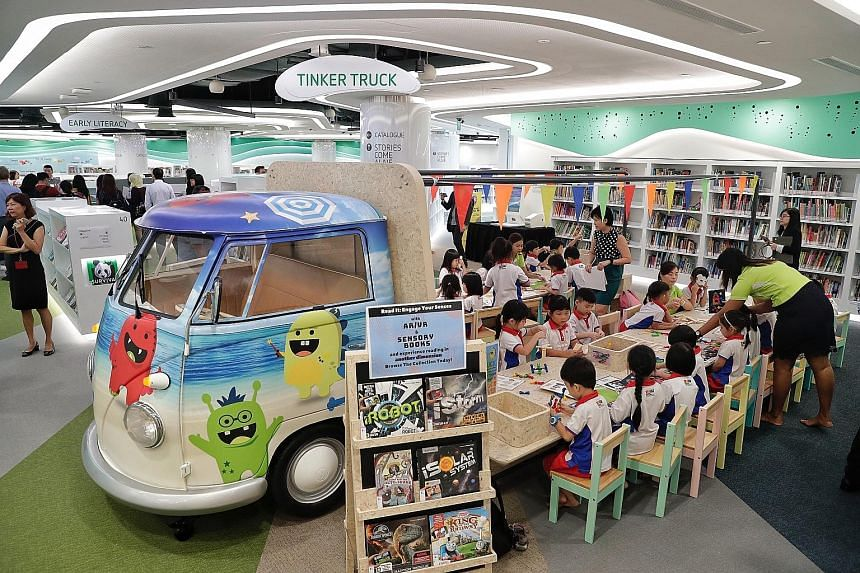 The coastal theme runs through the new facility on the third floor of VivoCity mall - from its blue-green colour scheme to deck chairs for readers to relax on as they browse the refreshed collection of 200,000 books. The children's zone of the new li