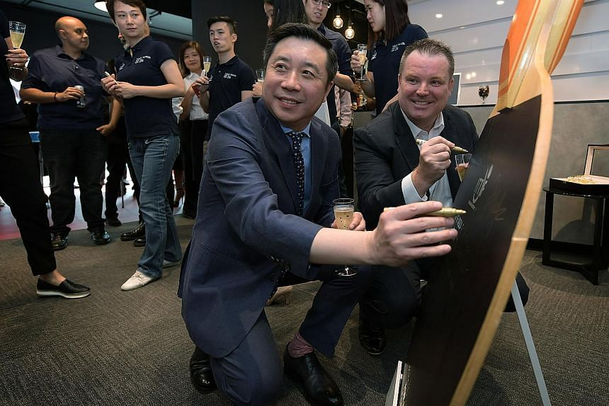 International Table Tennis Federation CEO Steve Dainton with Chinese businessman Frank Ji, whose shipping company Seamaster is a major sponsor of world table tennis, at the opening of the ITTF's new Asia-Pac office in Singapore.