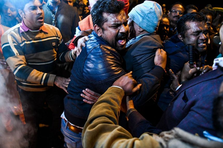Indian Hindu activists clash with police personnel during a demonstration over two women entering the Sabarimala Ayyapa temple in Kerala, New Delhi, on Jan 3, 2019.