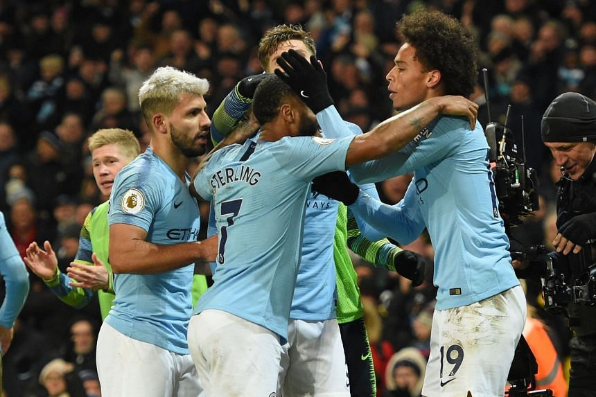 Manchester City's Leroy Sane (right) celebrates with team mates after scoring their second goal.