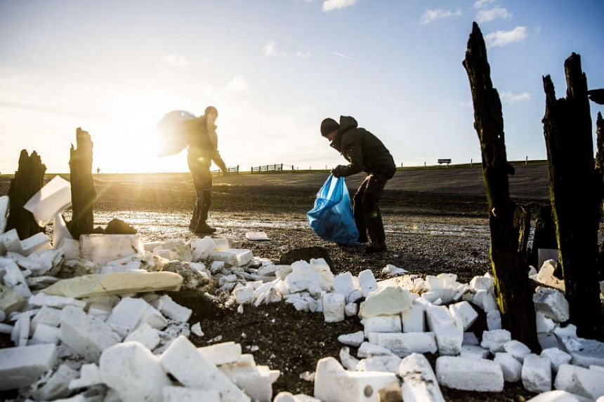 Volunteers handling washed up content from containers from Panamian-flagged MSC Zoe container vessel in Moddergat, The Netherlands, on Jan 3, 2019.