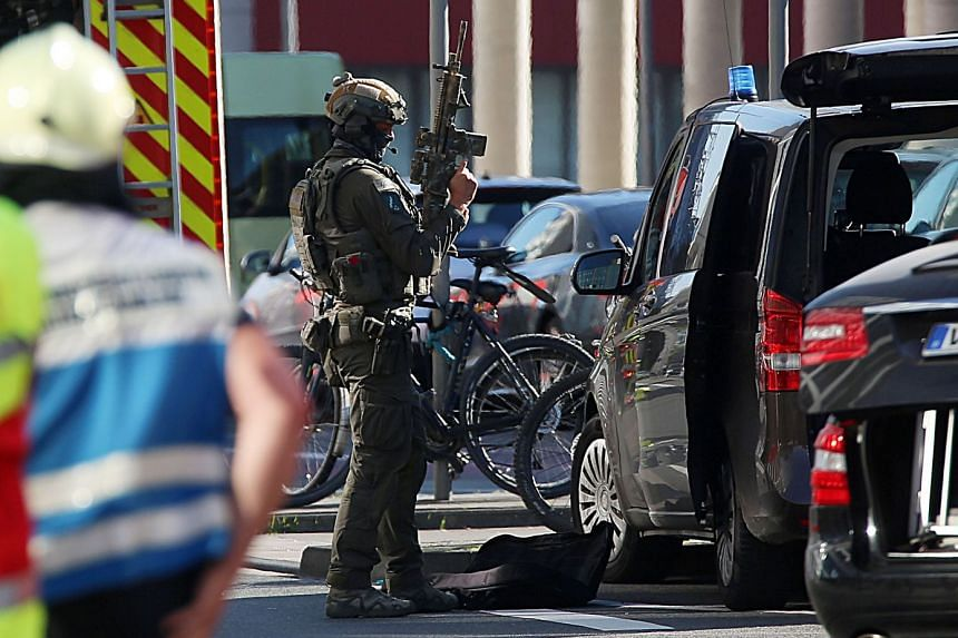 Police special forces are seen during a hostage taking incident in Cologne in October 2018.