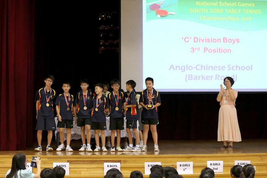 (From left) The ACS (Barker Road) C Division squad Ryan Tan, Silas Chua, Seth Wong, Benjamin Wee, Ethan Ong, Ryan Eng and Ryan Chong receiving their 3rd place medal at the South Zone C Division boys' table tennis championship in February 2018.