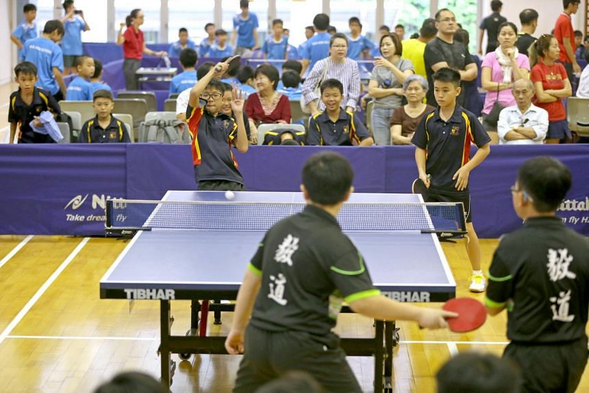(From left) The Anglo-Chinese School (Barker Road) Table Tennis team players Ethan Ong and Silas Chua playing doubles at the preliminary round of the National School Games in March 2018.