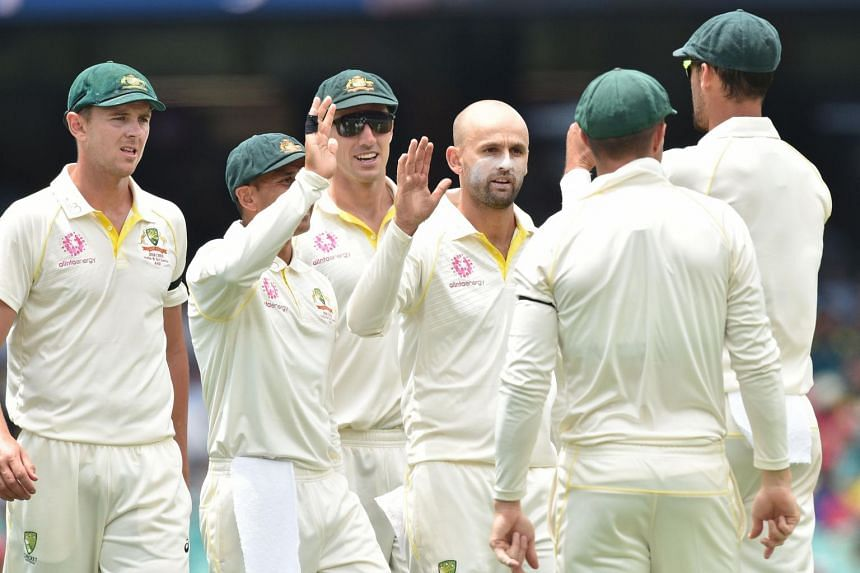 Australia's Nathan Lyon (centre) celebrates taking the wicket of India batsman Mayank Agarwal during the first day of the fourth and final cricket Test, on Jan 3, 2019.