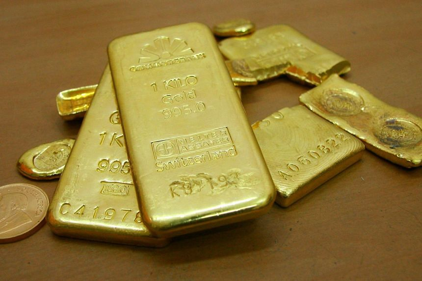 US gold futures were up 0.3 per cent at US$1,298.70 per ounce.