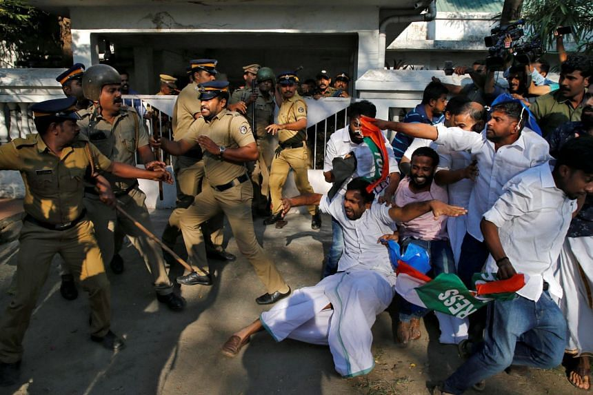 Members of Kerala Students Union, the student wing of India's main opposition Congress party, clashing with police outside a police station during a protest in Kochi yesterday. Hindu devotees are protesting over the entry of two women at Sabarimala