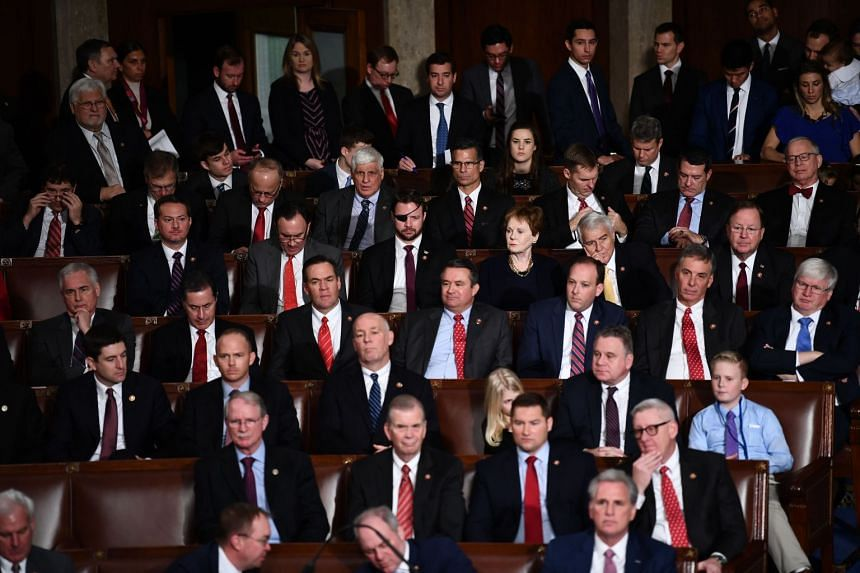 Members of Congress sit during the 116th Congress and swearing-in ceremony.