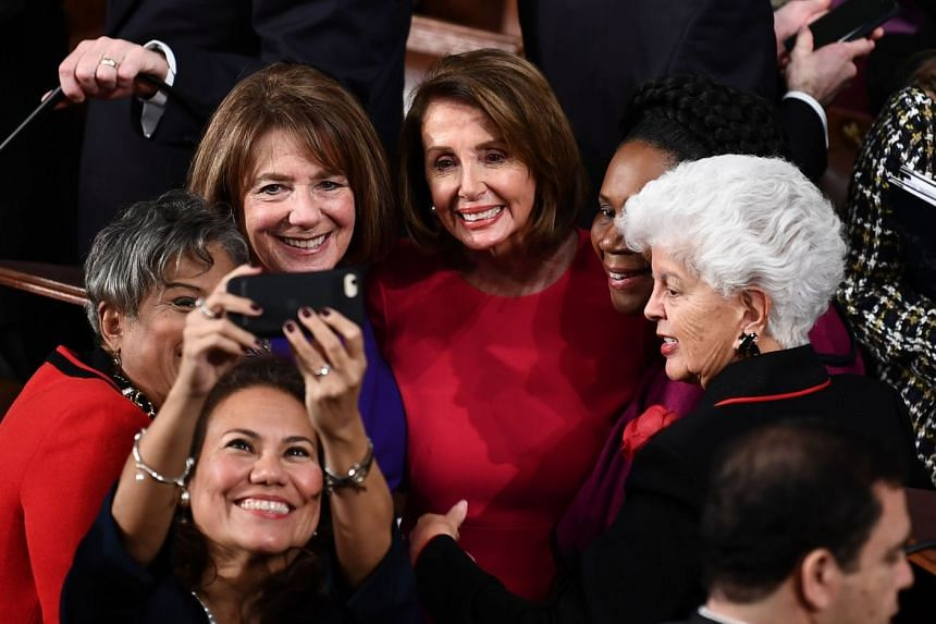 Pelosi (centre) is photographed with fellow Congresswomen during the opening session of the 116th Congress.