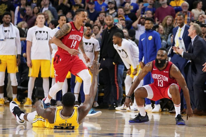 Houston Rockets guard James Harden celebrates after making the game-winning basket against Golden State Warriors forward Draymond Green (laying on the floor) during overtime at Oracle Arena on Jan 3, 2019.