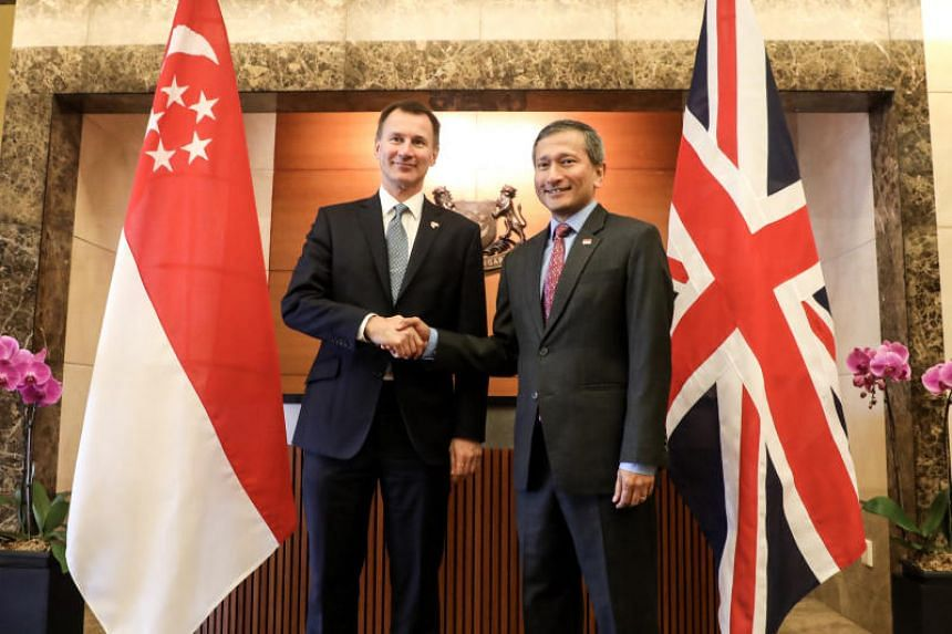 British Foreign Secretary Jeremy Hunt (left) made a call on Singapore's Foreign Minister Vivian Balakrishnan on Jan 4, 2019.