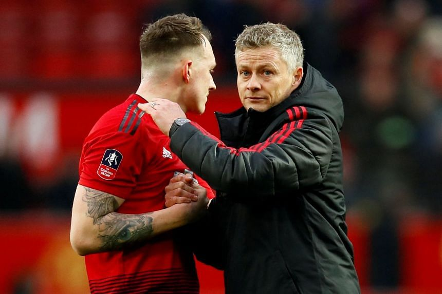 Manchester United interim manager Ole Gunnar Solskjaer with Phil Jones after the match.