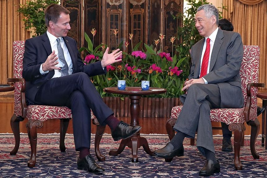 British Foreign Secretary Jeremy Hunt, who is here on an official visit, called on Prime Minister Lee Hsien Loong at the Istana yesterday. The two leaders reaffirmed the strong, growing and broad-based ties between Singapore and Britain.
