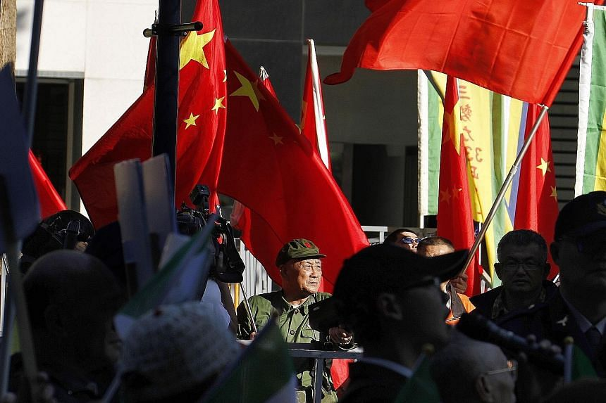 A pro-China demonstrator waving Chinese flags outside the venue of the Taipei-Shanghai Twin City Forum held in Taipei recently. Beijing has always regarded Taiwan as a breakaway province with no option but to return to the motherland.