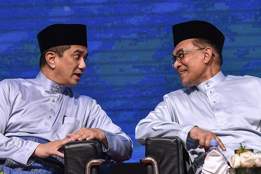 Parti Keadilan Rakyat (PKR) leader Anwar Ibrahim (right) chatting with PKR deputy president Azmin Ali last September. Mr Anwar's latest comments are seen as an acknowledgement of the tensions between the two of them.