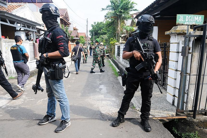 The Indonesian police's anti-terror unit Detachment 88 conducting a raid in Tangerang last May. A new anti-terror law passed last year allows police to make pre-emptive arrests, among other things.