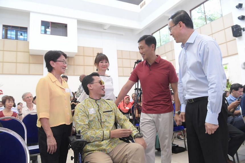 Minister for Education Ong Ye Kung and Dr Teo Ho Pin, Mayor of North West District, chat with Mr Muhammad Syafiq Mohammad Ali, who was helped by the SkillsFuture Advice programme, during an event to mark the anniversary of SkillsFuture Advice @ North