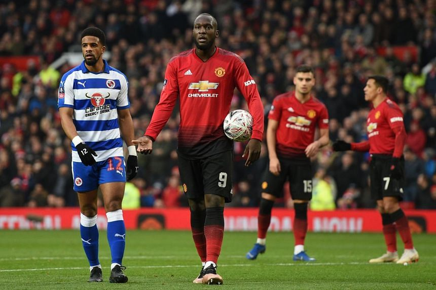 Lukaku (centre) reacts as the Video Assistant Referee (VAR) is consulted after Manchester United's Brazilian midfielder Fred put the ball in the back of the net, before ruling out the Fred goal and awarding a penalty for a foul on Manchester United's