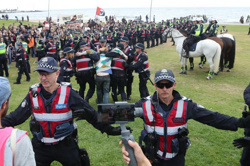 Police in riot gear spent more than three hours trying to separate the two groups who were yelling at one another at St Kilda Beach on Jan 5, 2019.