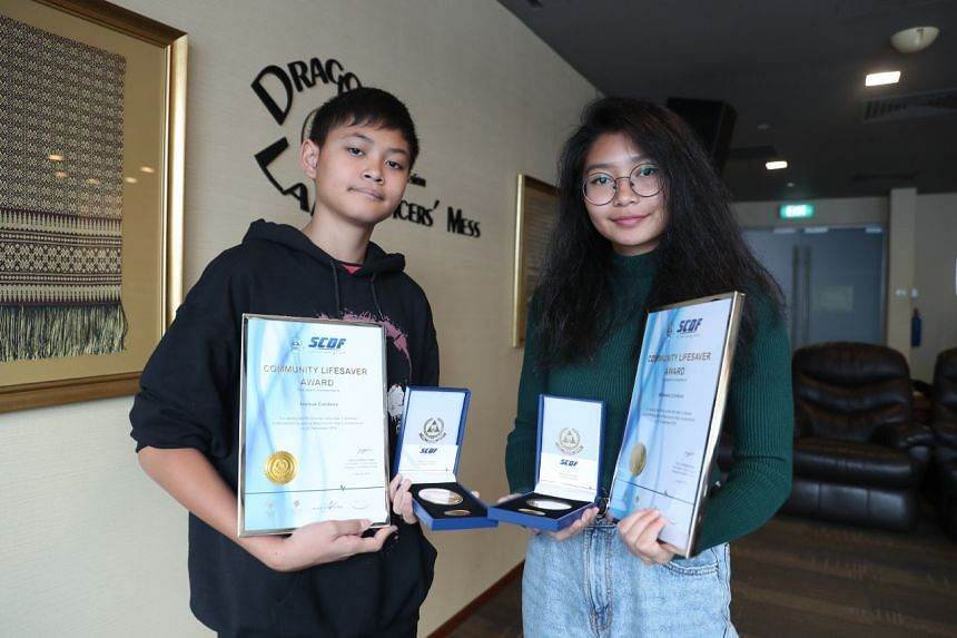 Miss Mikkaela Cordova (right) and her brother Joshua were presented the Community Lifesaver Awards by the Singapore Civil Defence Force (SCDF) on Jan 5.