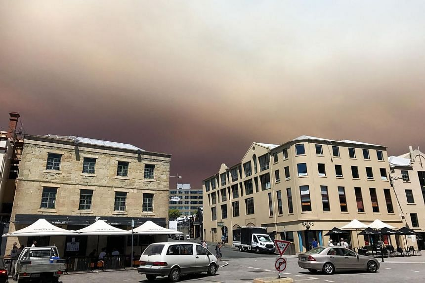 Smoke from an out of control bushfire burning in a Tasmanian Wilderness World Heritage Area clouds the sky at Salamanca Place in Hobart, Australia, on Jan 4.