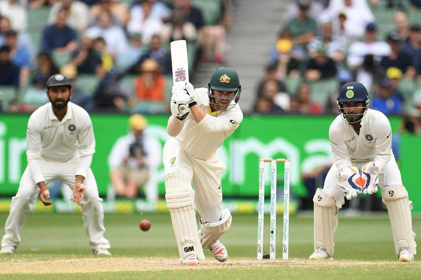 Travis Head of Australia (centre) bats during day four of the Boxing Day Test match between Australia and India, on Dec 29, 2018.