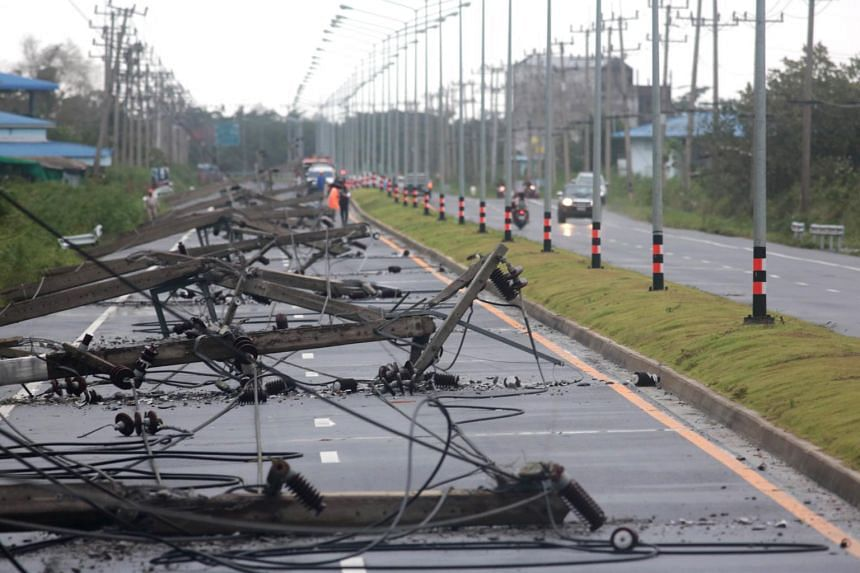 Collapsed electricity posts caused by Tropical Storm Pabuk are seen along along a main street at Pak Phanang district, Nakhon Si Thammarat province, on Jan 4, 2019.