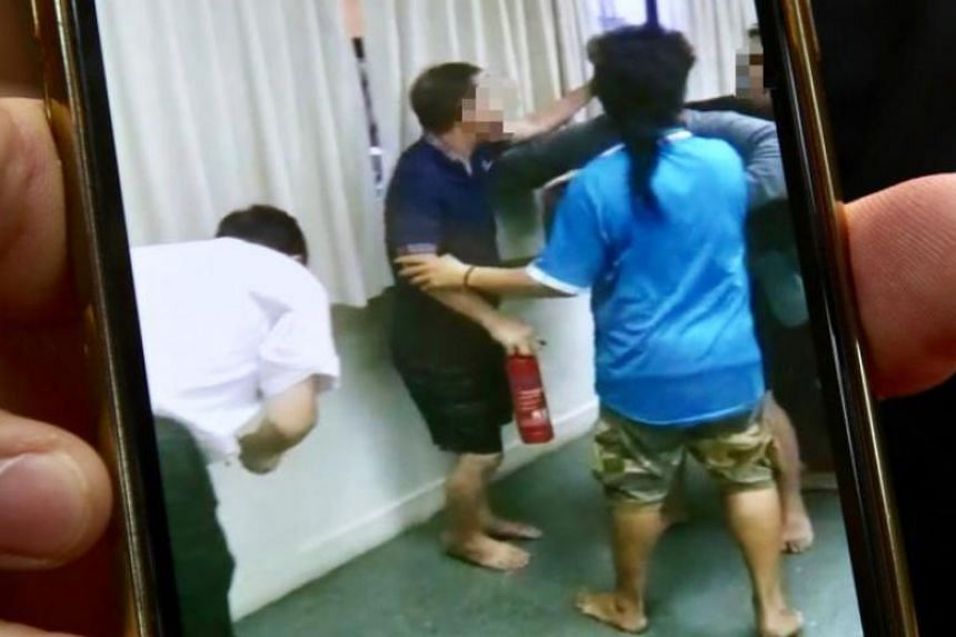 The fracas between one of the debt collectors and the staff of the vegetable and fruit stall is captured on video.
