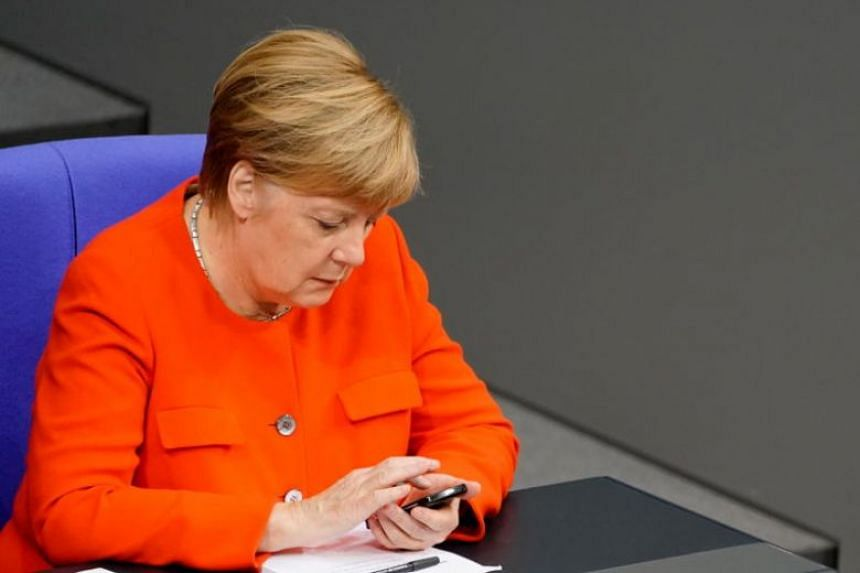 Beyond politicians, including Chancellor Angela Merkel (above), celebrities and journalists were also targeted.