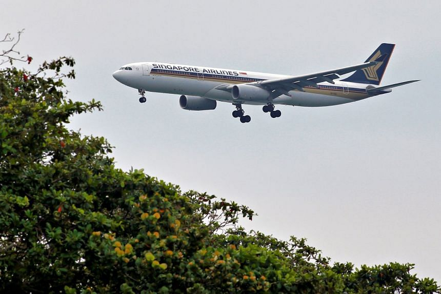 A Singapore Airlines Airbus A330-300 plane approaches to land at Changi International Airport.