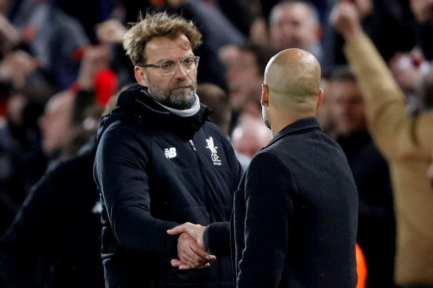 Klopp (left) shaking hands with Manchester City manager Pep Guardiola after a match.
