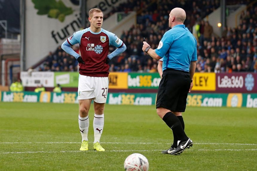 Burnley's Matej Vydra waits to take a penalty which is later overturned by VAR.