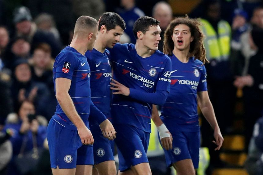 Chelsea's Alvaro Morata celebrates with Chelsea's Ross Barkley and Andreas Christensen after scoring.