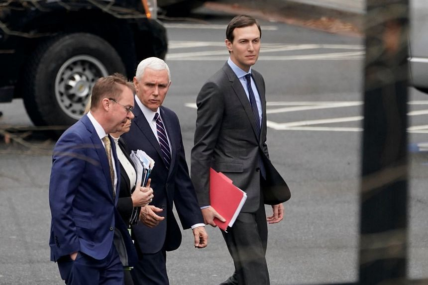 (From left) Mick Mulvaney, Kirstjen Nielsen (obscured), Mike Pence and Jared Kushner walk from the West Wing before a meeting with Congressional staffers about ending the partial government shutdown.