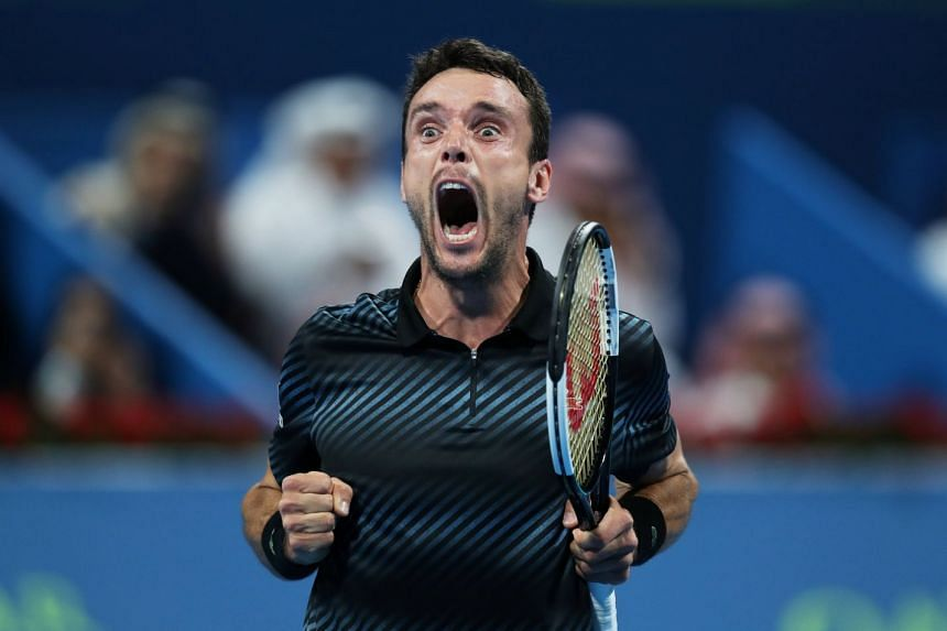 Bautista Agut celebrates winning the final against Czech Republic's Tomas Berdych.
