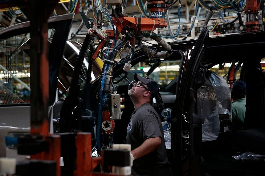 An assembly line at a Ford Motor Company complex in Michigan. The probability of a US recession over the next 12 months is 30 per cent, say some analysts. Others note that the US economy accelerated last year, boosted by robust consumption and a pick