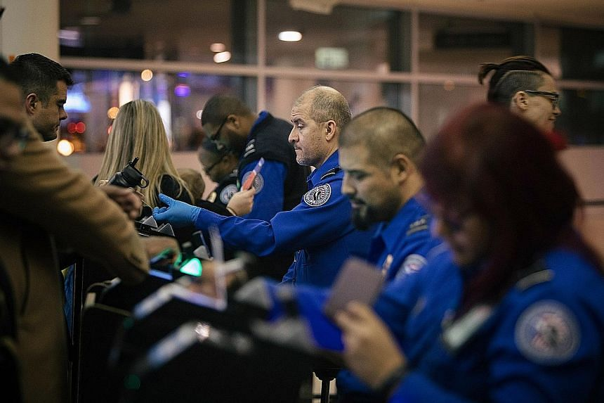 US Transportation Security Administration (TSA) agents continuing their work at Chicago's Midway International Airport on Dec 22, despite the partial government shutdown, which has affected an array of American federal institutions and services.